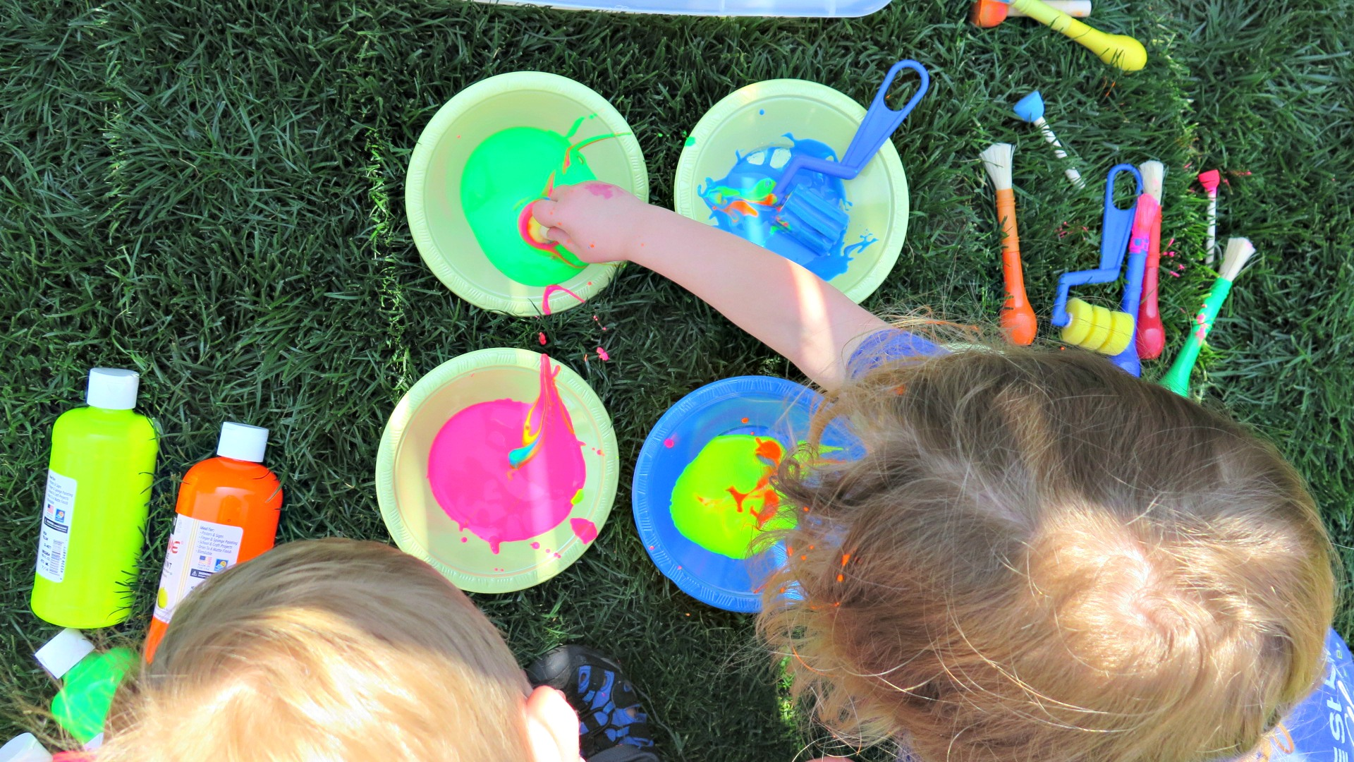 Water, washable paint, 25-foot banner paper, fun brushes and painting objects + a paint shirt = a good childhood.